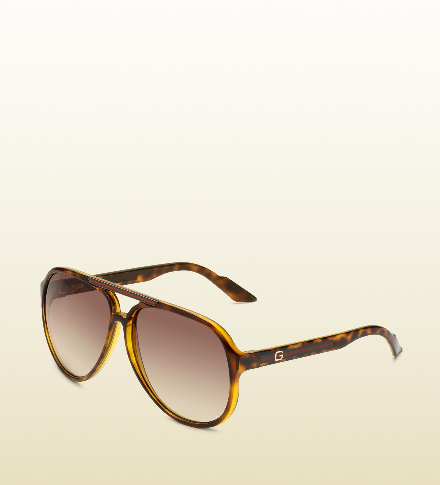 e8e21be47ba Lyst - Gucci Medium Aviator Sunglasses With G Detail And Signature ...