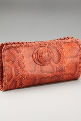 Bottega Veneta Python Turnlock Clutch - Lyst