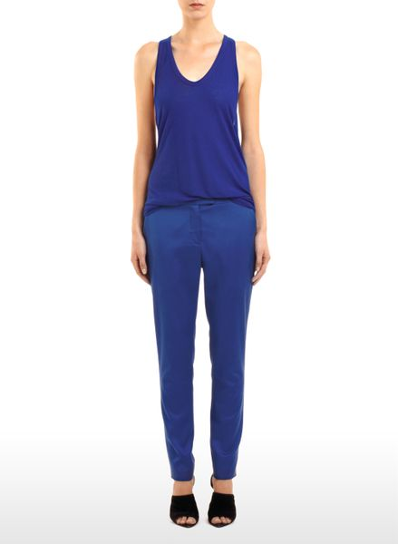 Alexander Wang Cropped Stretch Viscose Cupro Twill Trousers in Blue (indigo) - Lyst