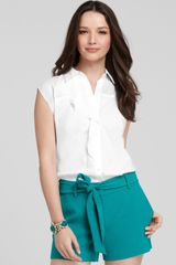 Ann Taylor Petite Ruffle Front Sleeveless Button Down Shirt - Lyst