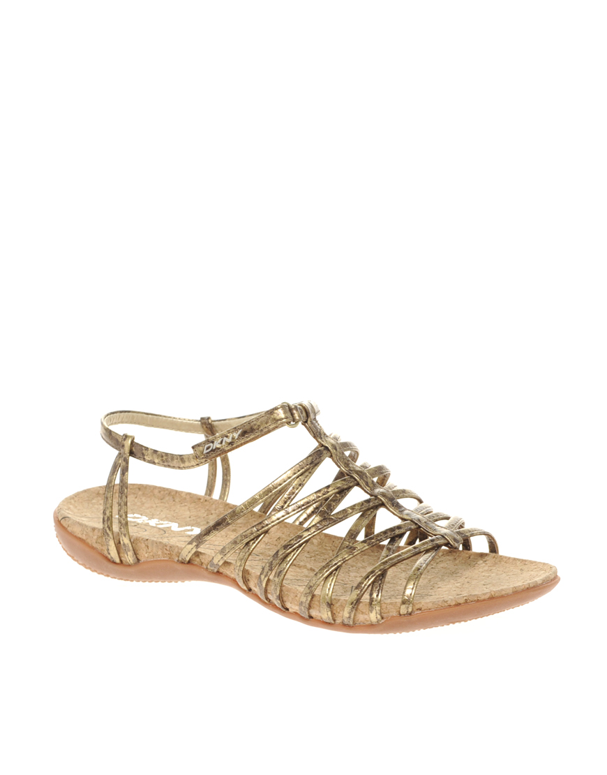 85e0fb65254b Dkny Active Kallipso Strappy Flat Sandals in Gold