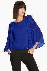 Alice + Olivia Briar Pleated Bell Sleeve Top - Lyst