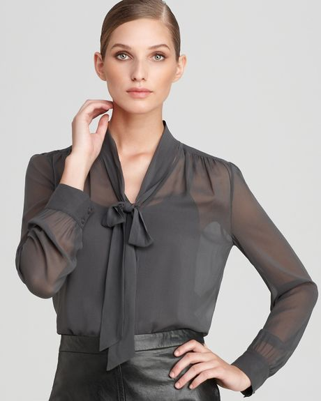dkny sleeve tie neck blouse in gray iron lyst