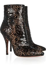 Alaïa Laser Cut Patent Leather Boots in Black - Lyst