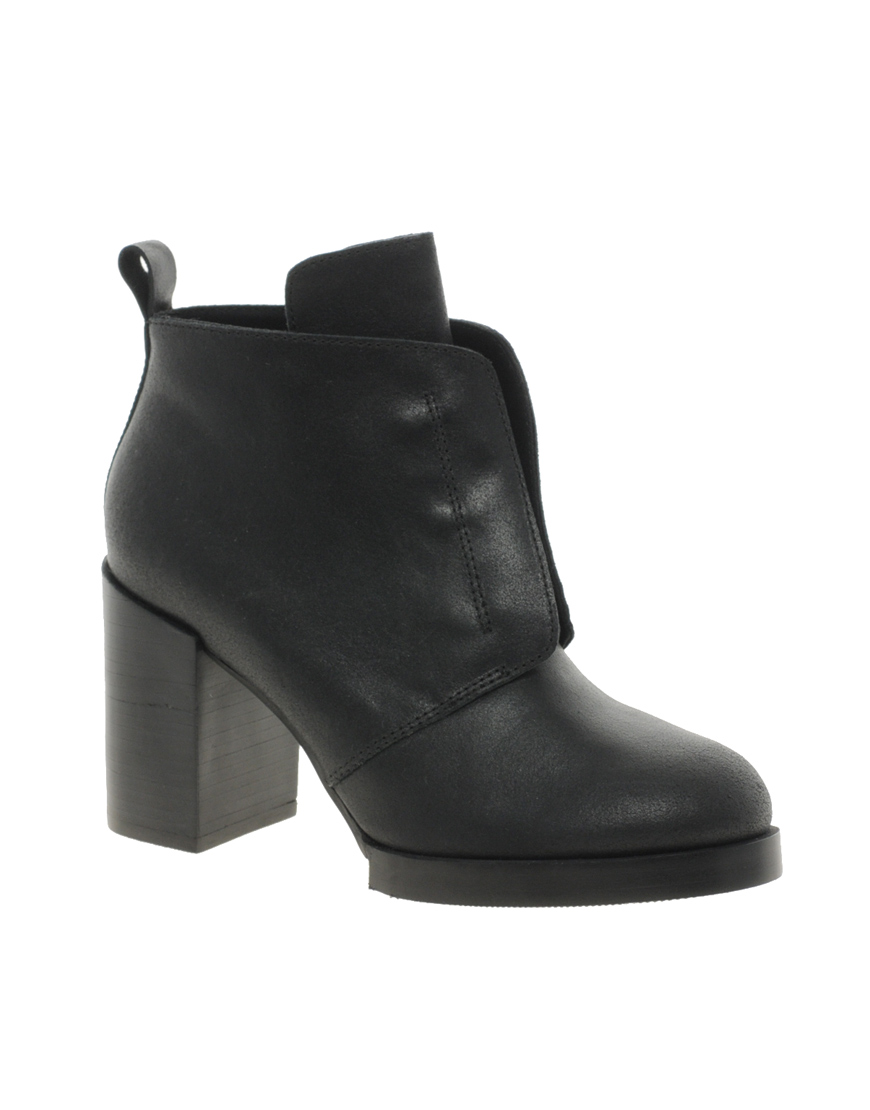 cheap monday layer ankle boots in black lyst