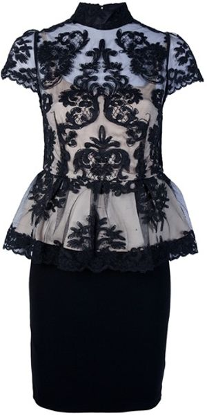 Alice + Olivia Peplum Lace Top in Black - Lyst