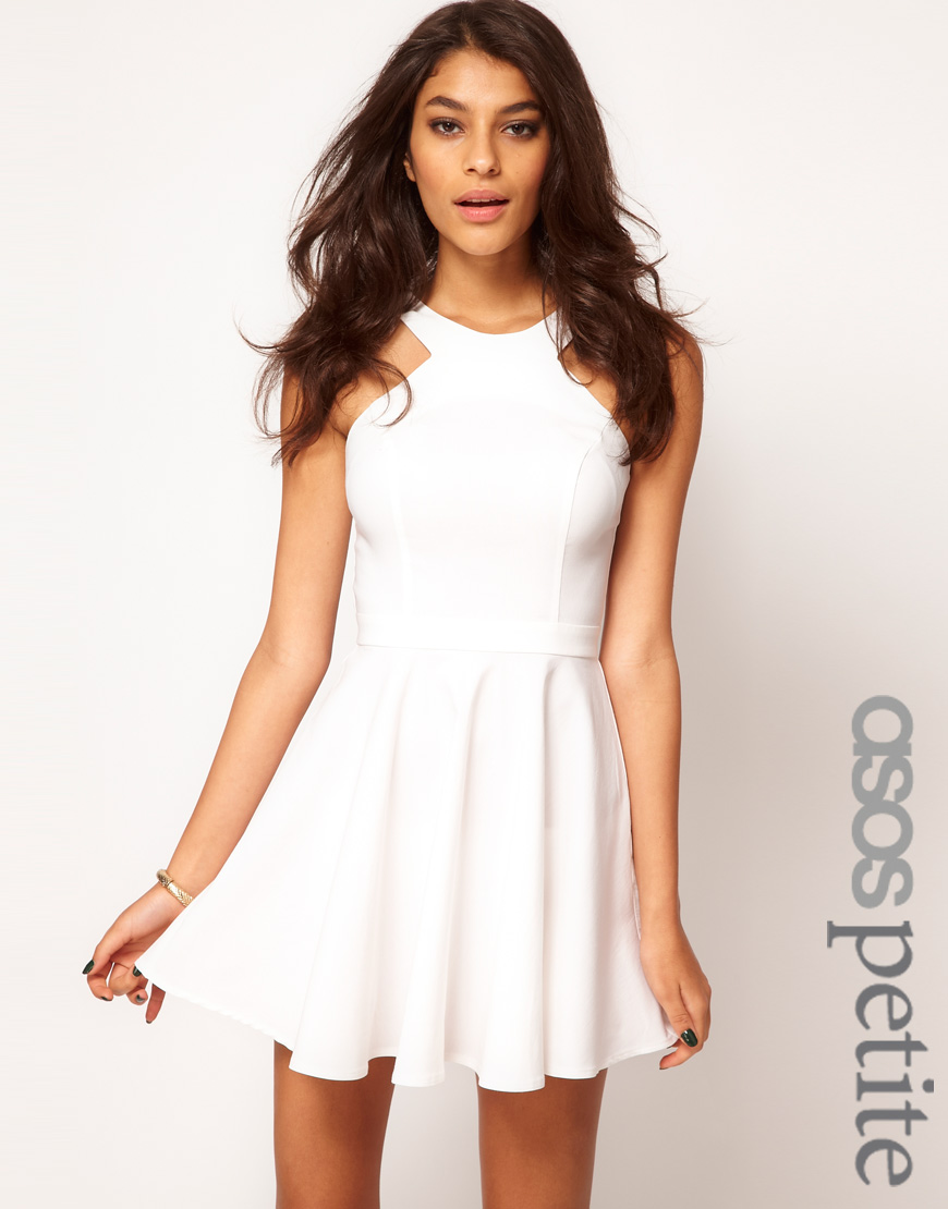 The entire wedding party and all the guests wear white, and we have the perfect little white dresses for you to wear. Show off your beautiful shoulders and arms in a one shoulder dress. Go bohemian with a billowy dress featuring soft layers.