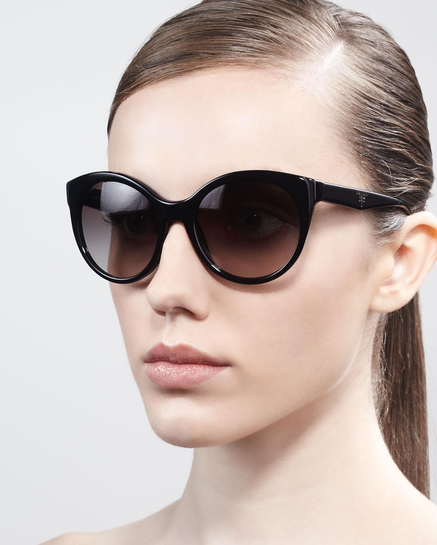 724c9cf9dc05 Lyst - Prada Rounded Cateye Sunglasses in Brown