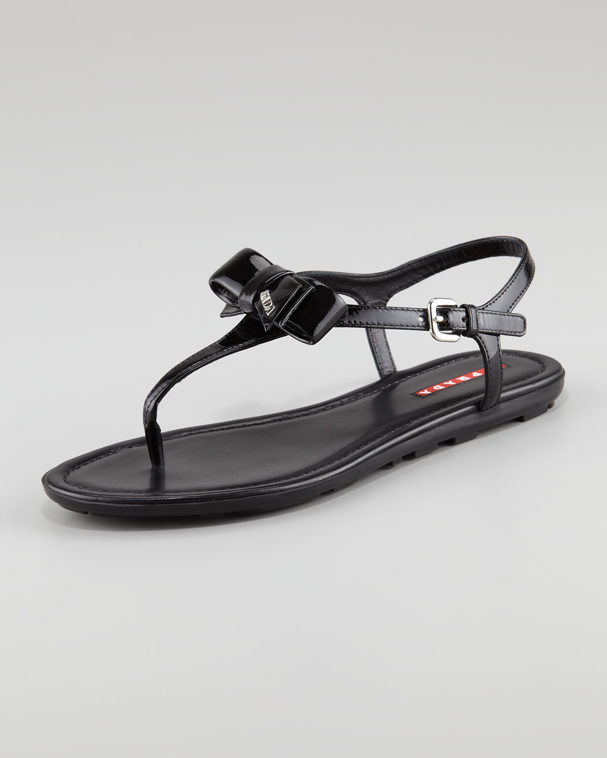 018075b70fdc75 Lyst - Prada Patent Leather Bow Thong Sandal in Black