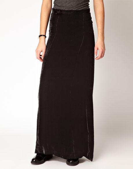 ganni silk velvet maxi skirt in black lyst