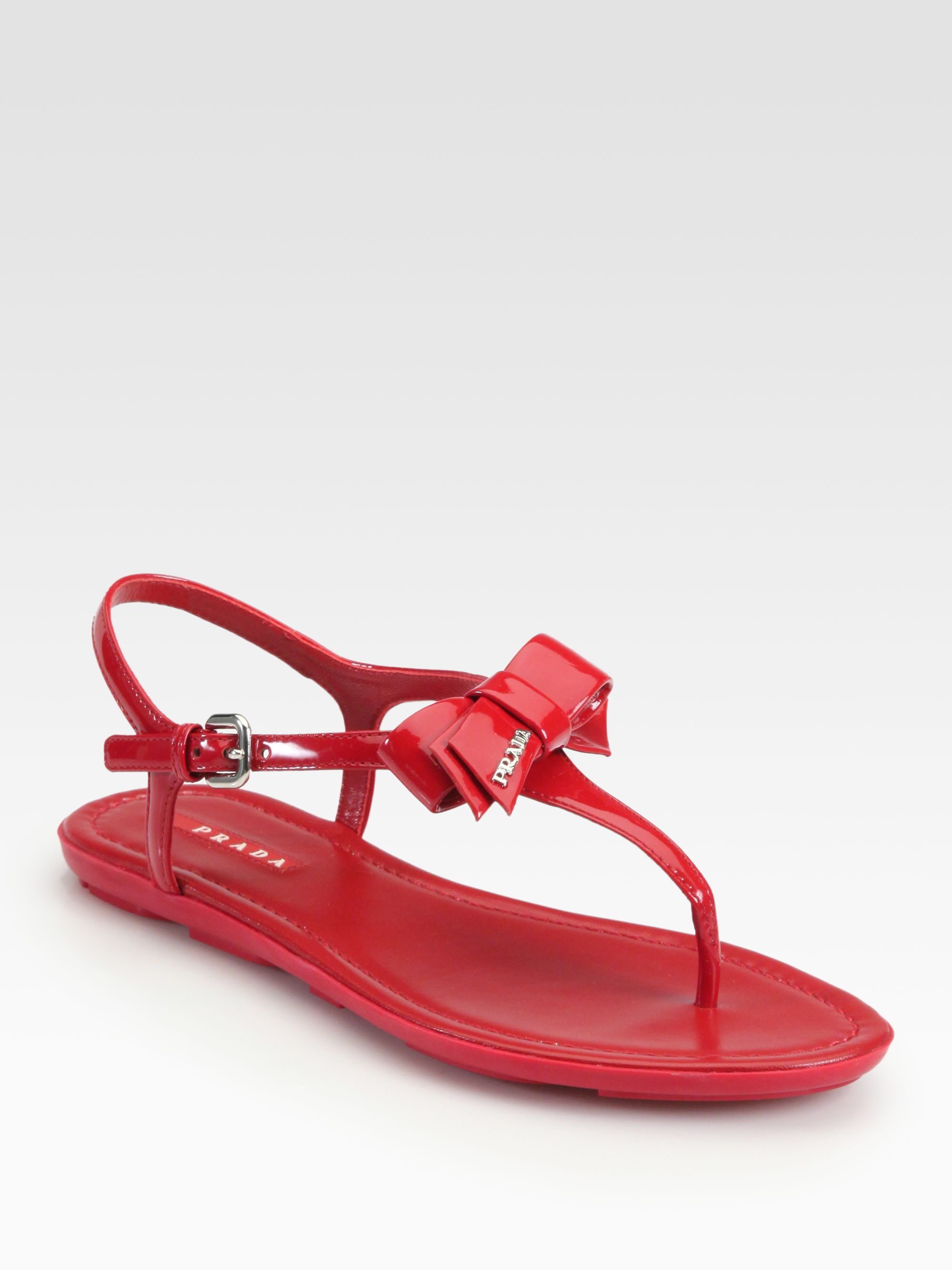 86f0a588d Lyst - Prada Patent Leather Bow Thong Sandals in Red