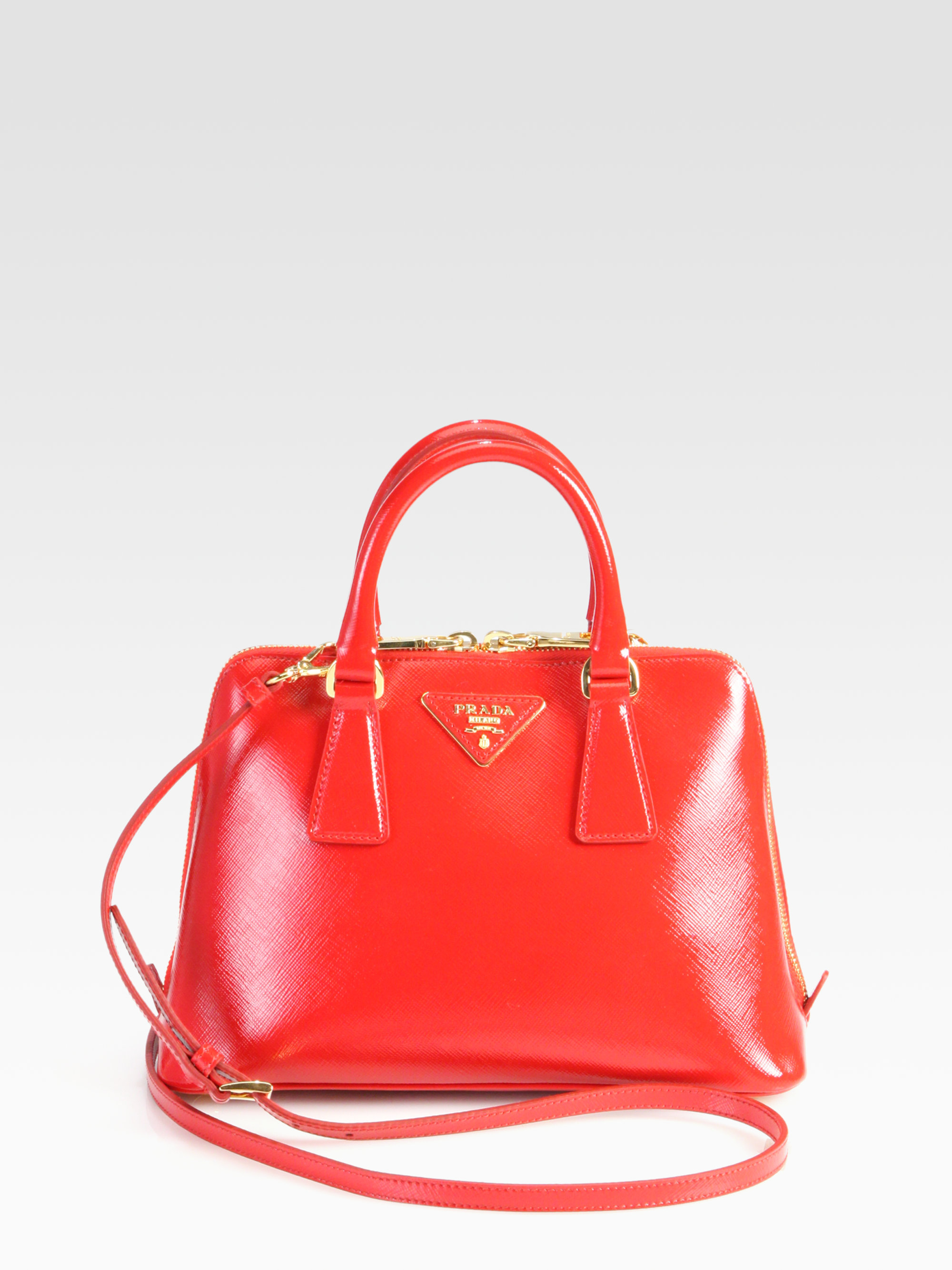 3507bd67dc8a ... get lyst prada saffiano vernice small round tophandle bag in red cf86f  ad703 ...