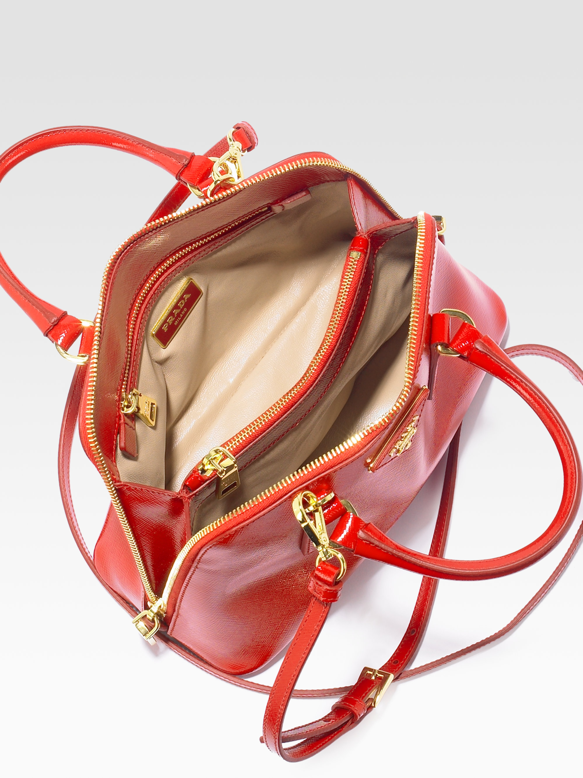 9d999a59b28a ... get lyst prada saffiano vernice small round tophandle bag in red 9bcf1  624dc