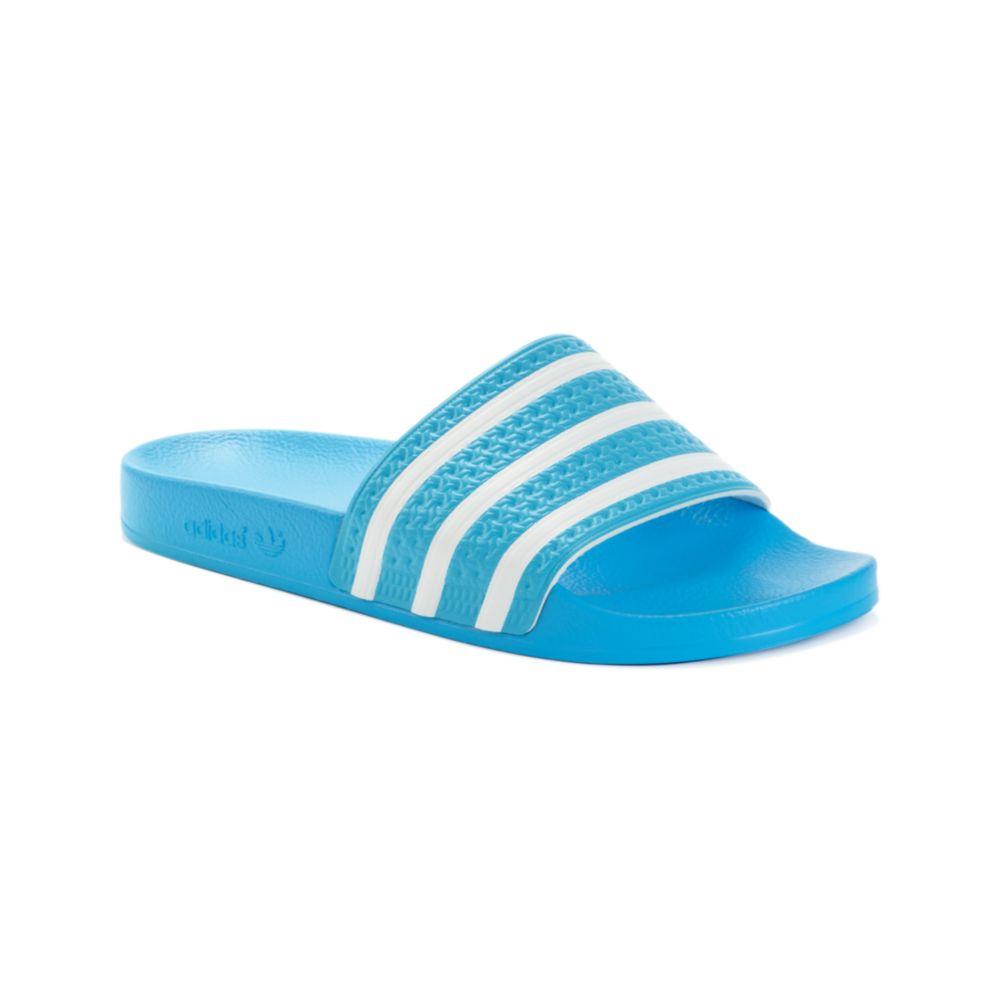 8cb21ef1599cb5 Lyst - adidas Adilette Slides in Blue for Men