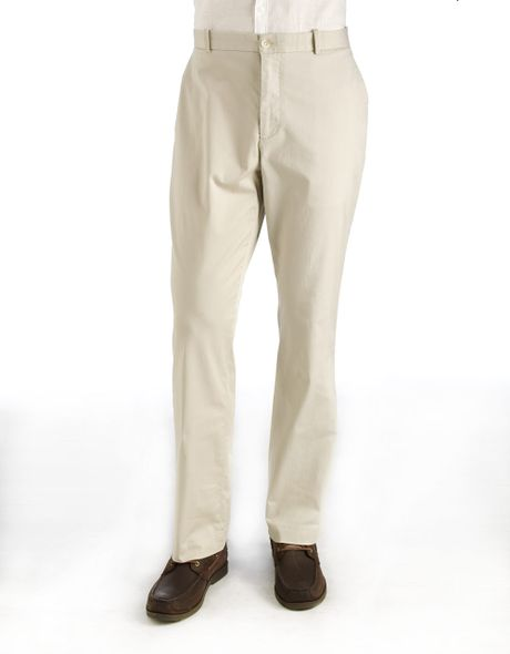 Elegant Countryclubissue Blue Blazers With Brass Buttons And Khaki Pants, And Above