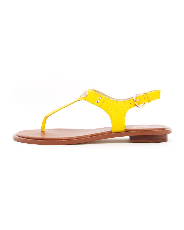 a3f61b40a67 Lyst - Michael Kors Flat Tstrap Thong Sandal in Yellow