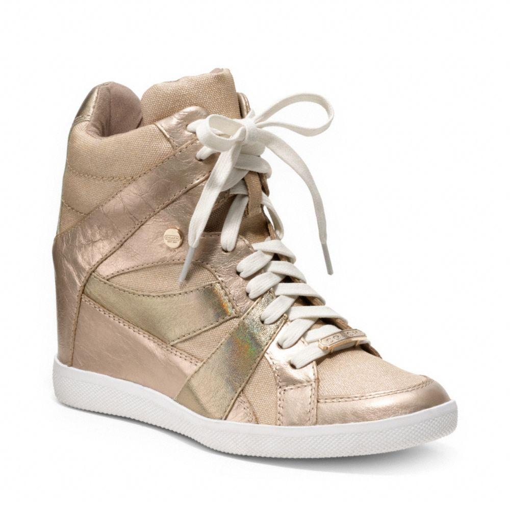 25f13b32efb Lyst - COACH Alexis Wedge Sneaker in Metallic