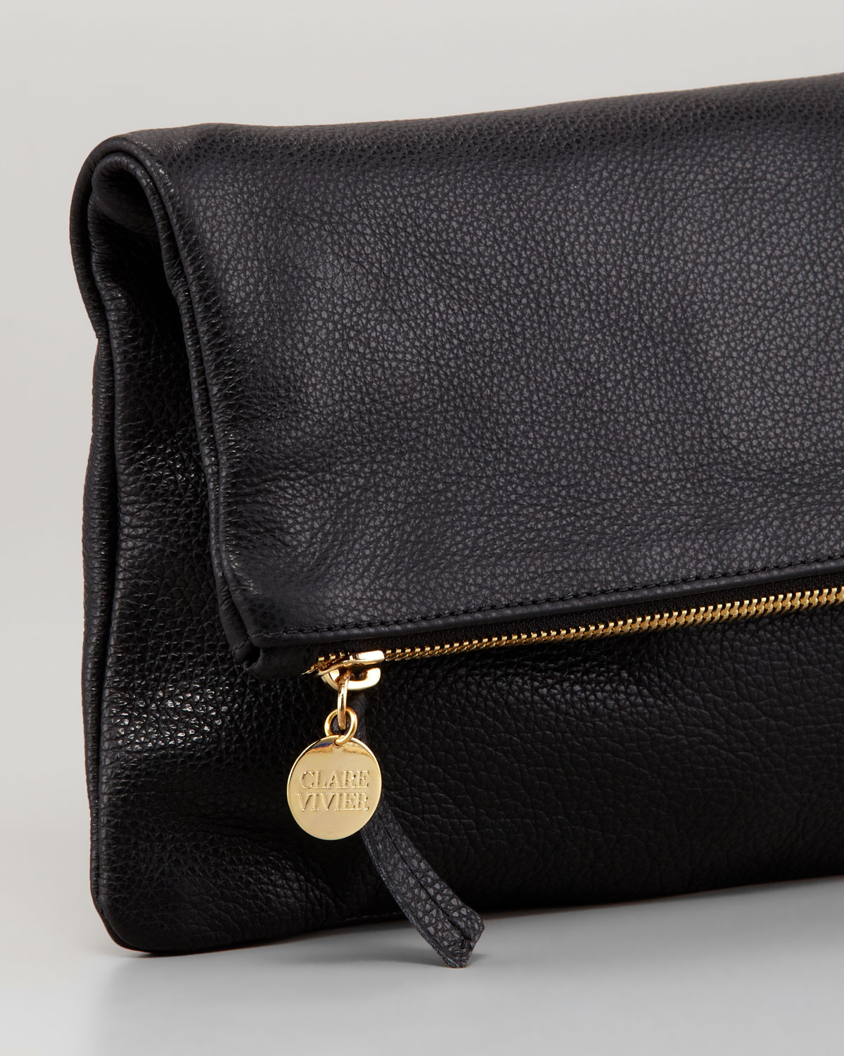 Black leather foldover top clutch bag from Coach. ModeSens is the premier Digital Fashion Shopping Assistant for the smart and informed. Learn more. A world of fashion, powered by technology. ModeSens pulls from the racks of 11,+ luxury brands, aggregating every product at the item level for a seamless, transparent and secure shopping.