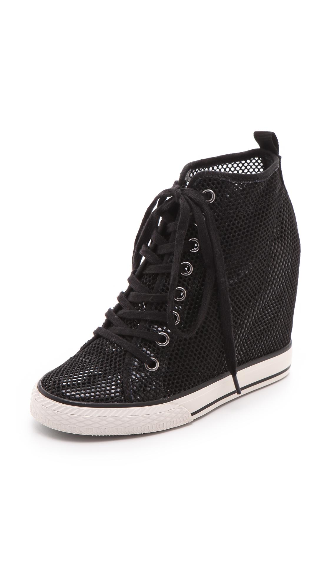 Lyst Dkny Grommet Wedge Sneakers In Black