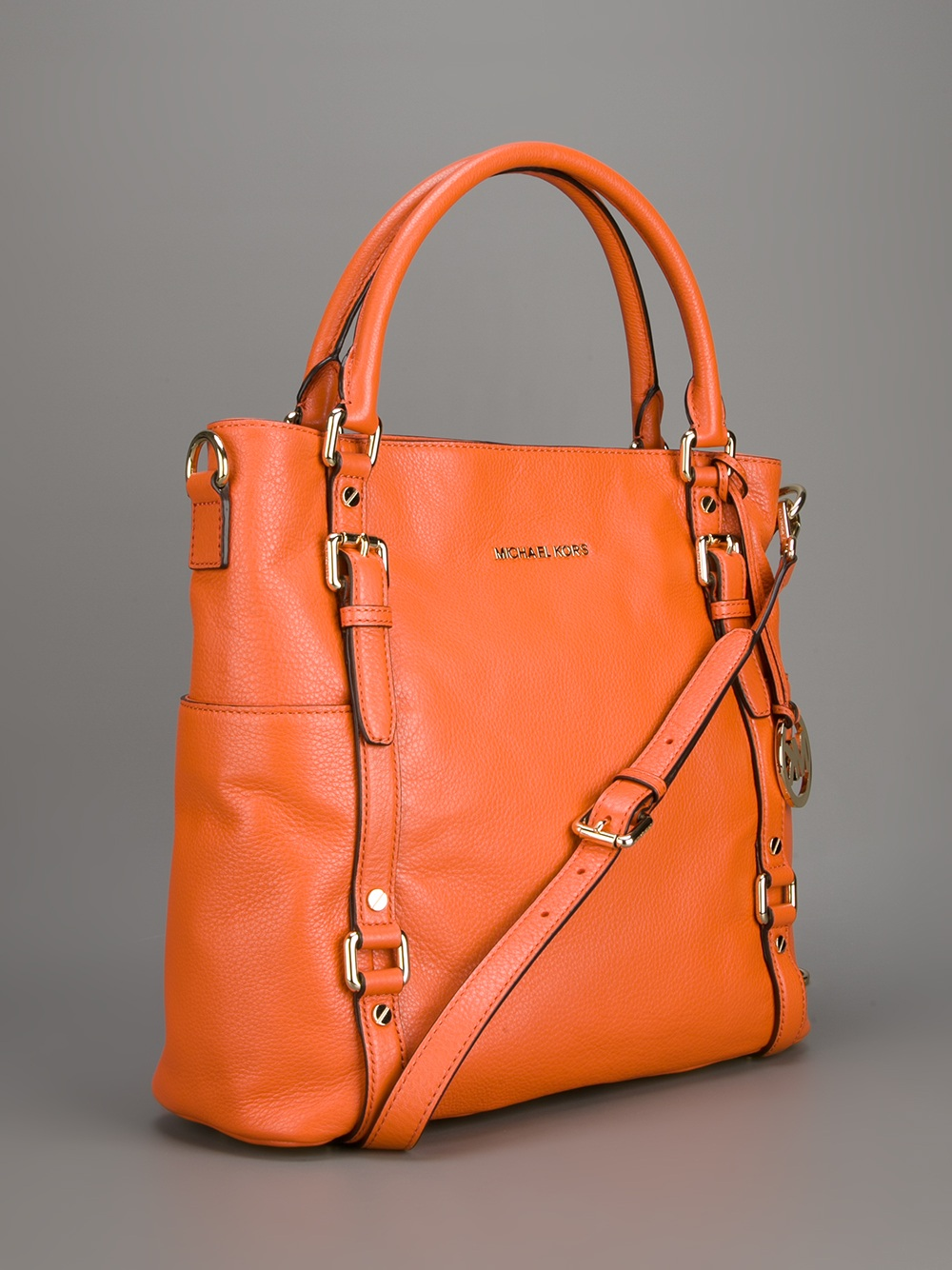 abc0328626cf Lyst - MICHAEL Michael Kors Buckle Strap Tote in Orange