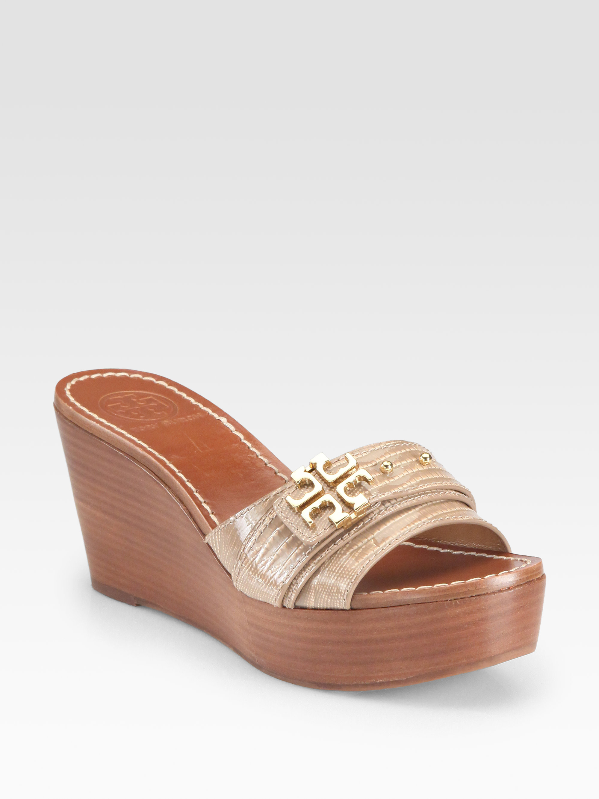 381e3c1a05a8 Lyst - Tory Burch Elina Lizardembossed Patent Leather Wedges in Metallic