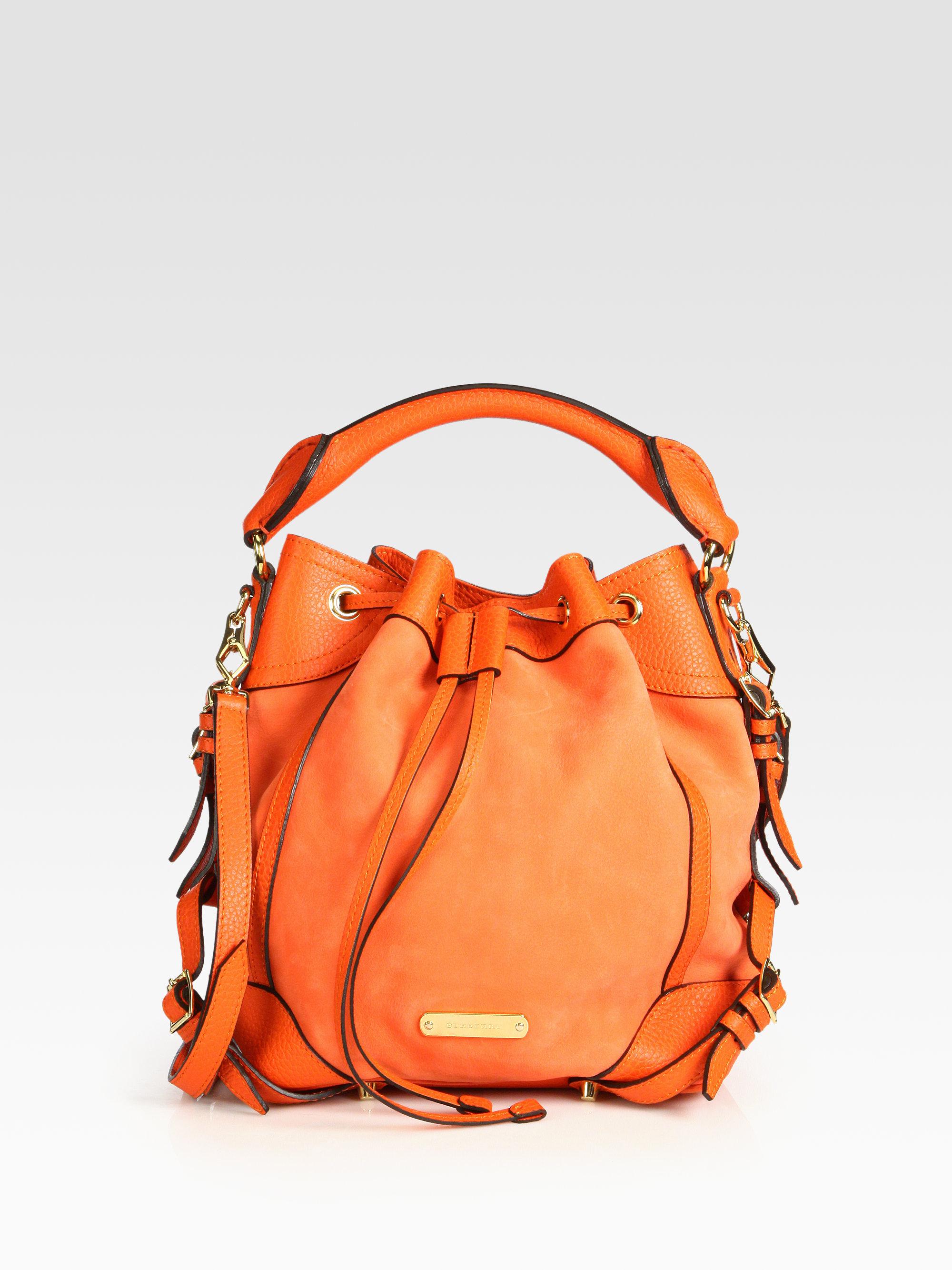 9e360fe22797 Lyst - Burberry Penbury Small Bucket Bag in Orange