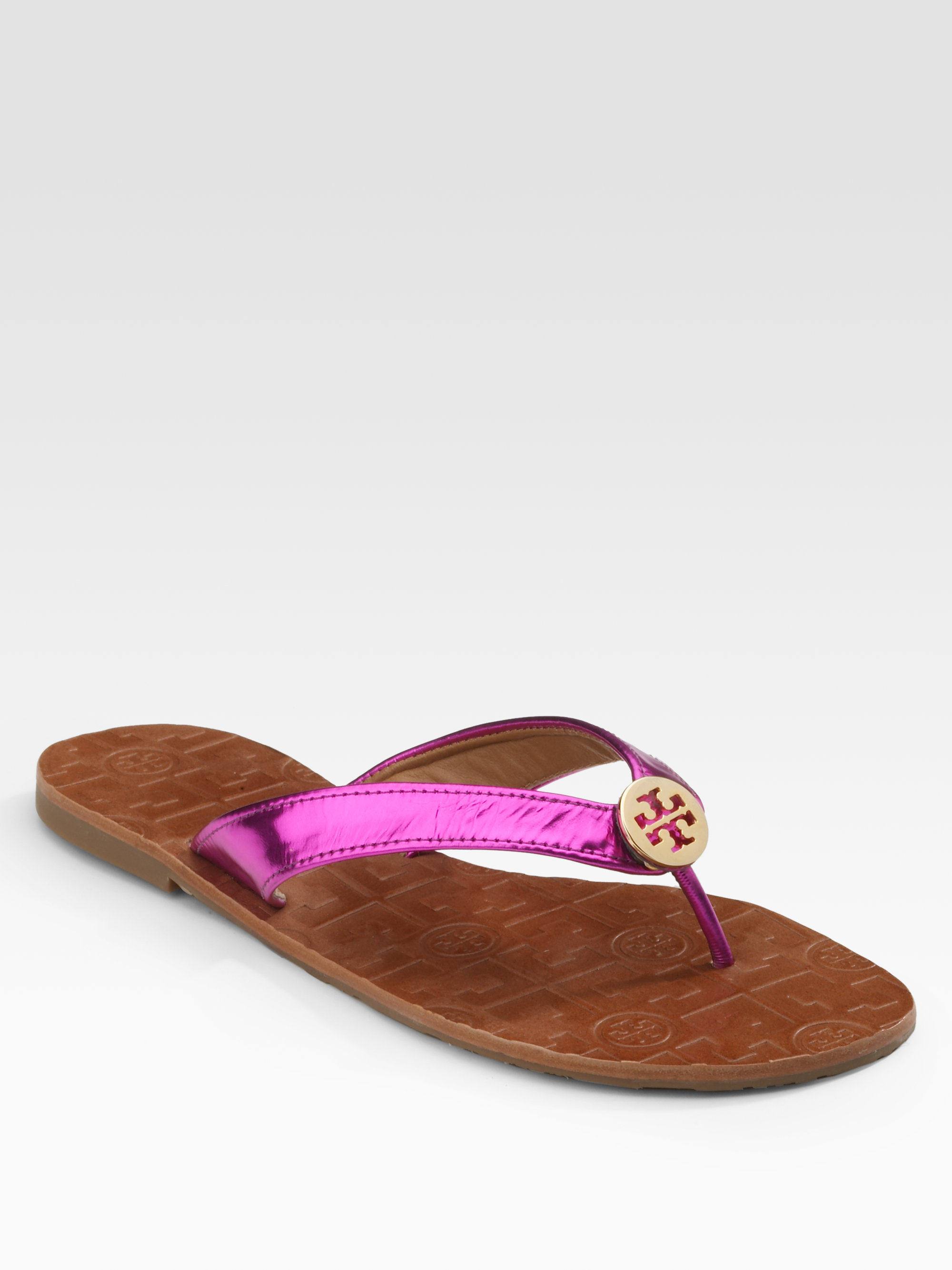 d99b838b27ec ... discount lyst tory burch thora metallic leather thong sandals in pink  a25dc 1cb3e