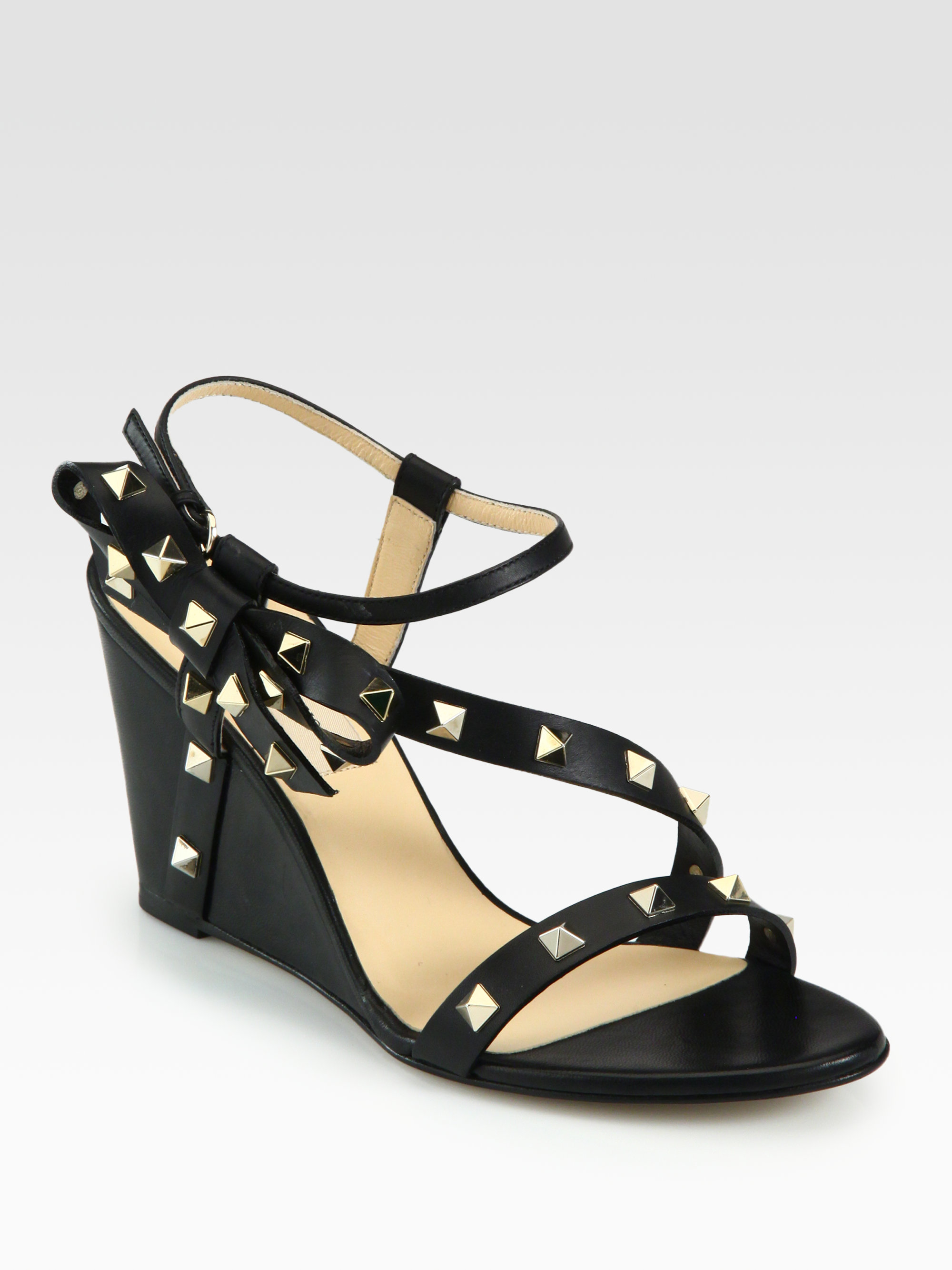 610a806bda3 Lyst - Valentino Rockstud Leather Bow Wedge Sandals in Black