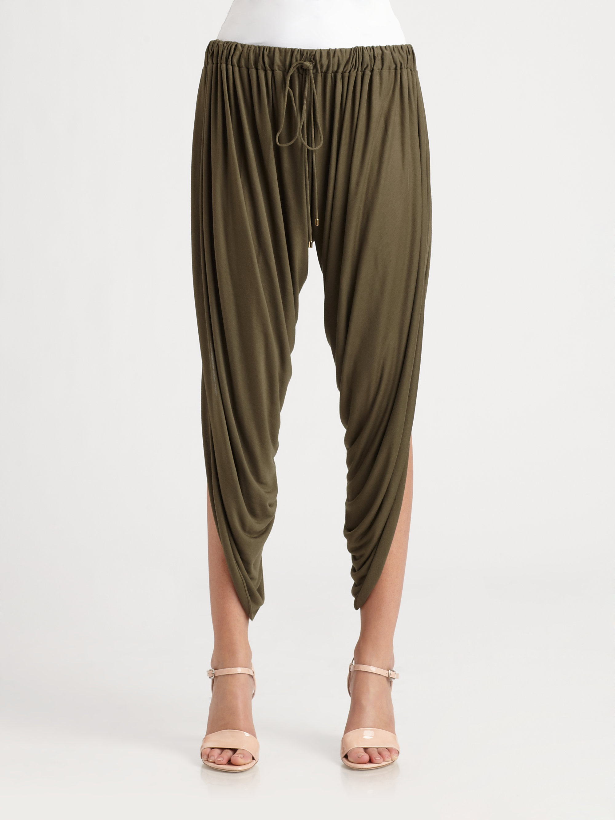 Haute Hippie cuts this bohemian-inspired pair of slouchy, draped pants from soft jersey. The relaxed legs are slit from the waist to the hem, with a small seam in the middle, and the gathered elastic waist is outfitted with a drawstring for an easy fit. Fabric: Soft jersey. % modal. Hand wash or.