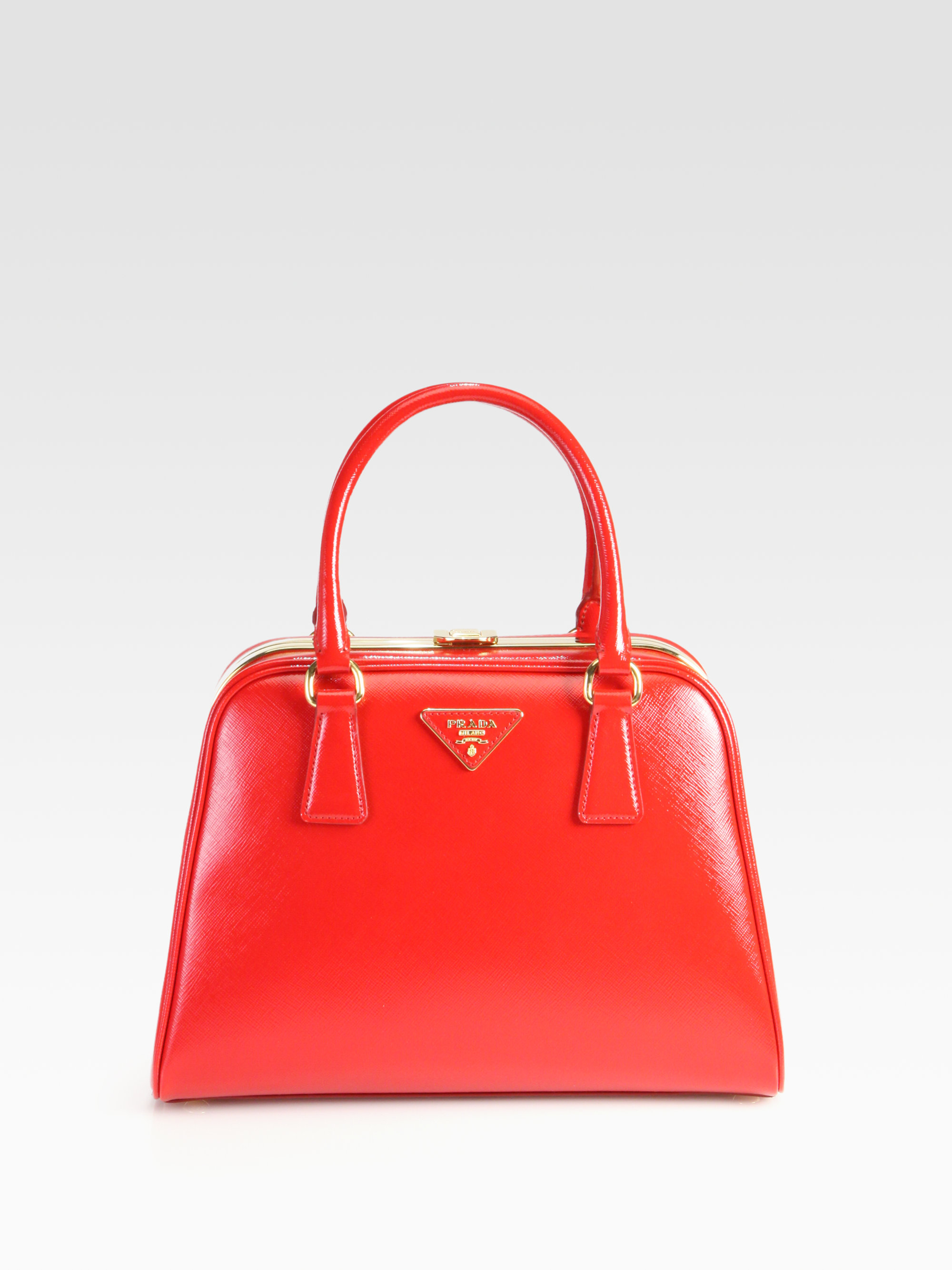 f2ae0ace2d54 ... netherlands prada saffiano vernice frame pyramid top handle bag in red  lyst 7a6ac 33890