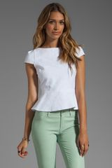 Alice + Olivia Roz Short Sleeve Boatneck Peplum Top - Lyst