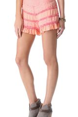 Free People Acid Washed Ruffle Shorts - Lyst