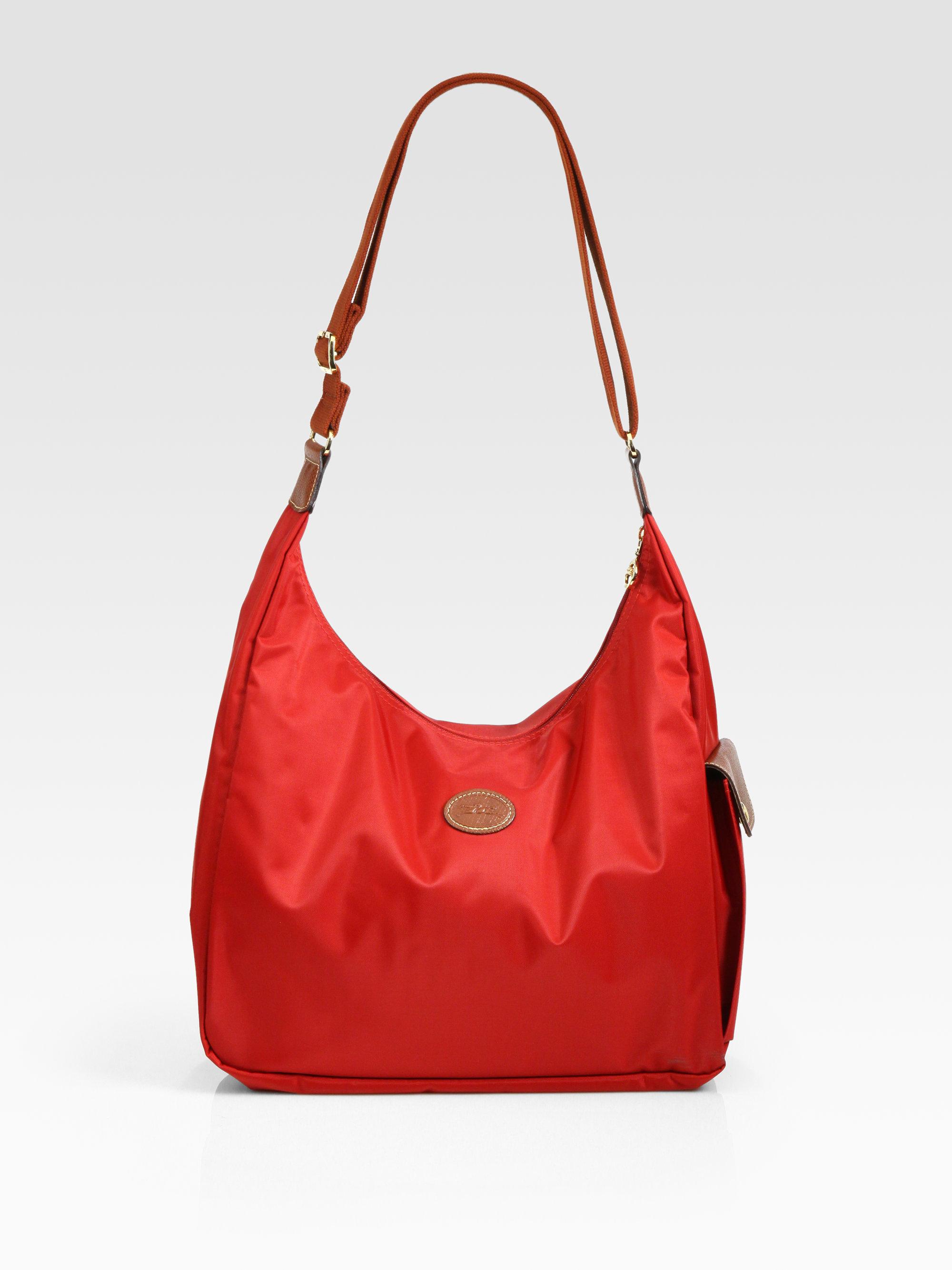longchamp le pliage hobo bag in red lyst. Black Bedroom Furniture Sets. Home Design Ideas