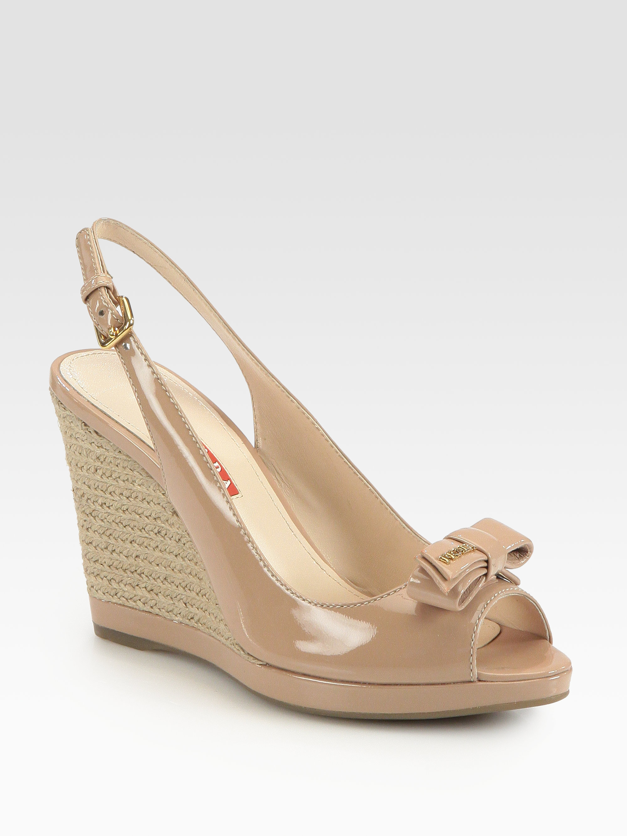 2be3edad541 Lyst - Prada Patent Leather Bow Espadrille Wedge Sandals in Natural