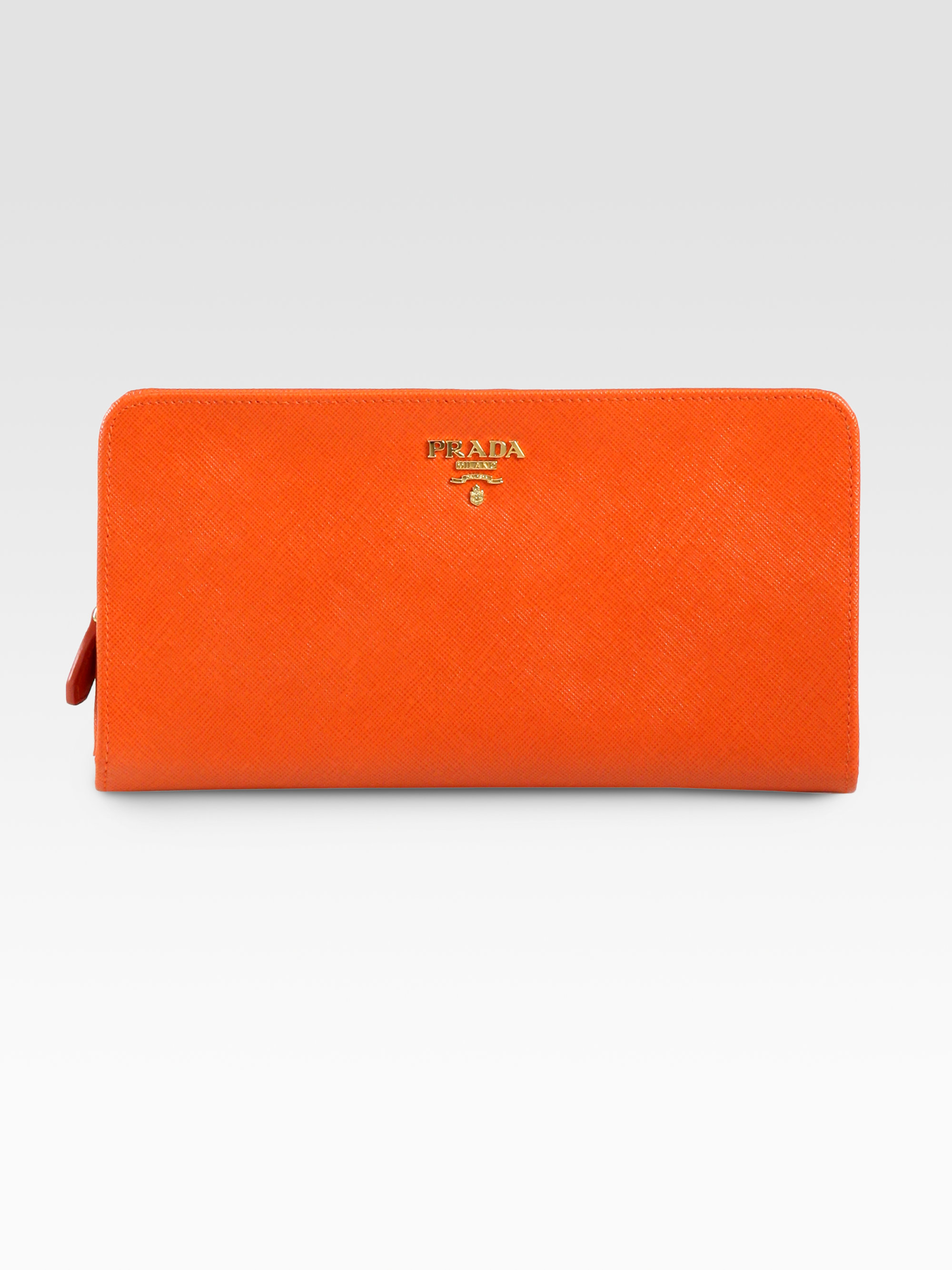 e3f0c77a663d ... coupon code for lyst prada saffiano double snap travel wallet in orange  d9af3 b95f8