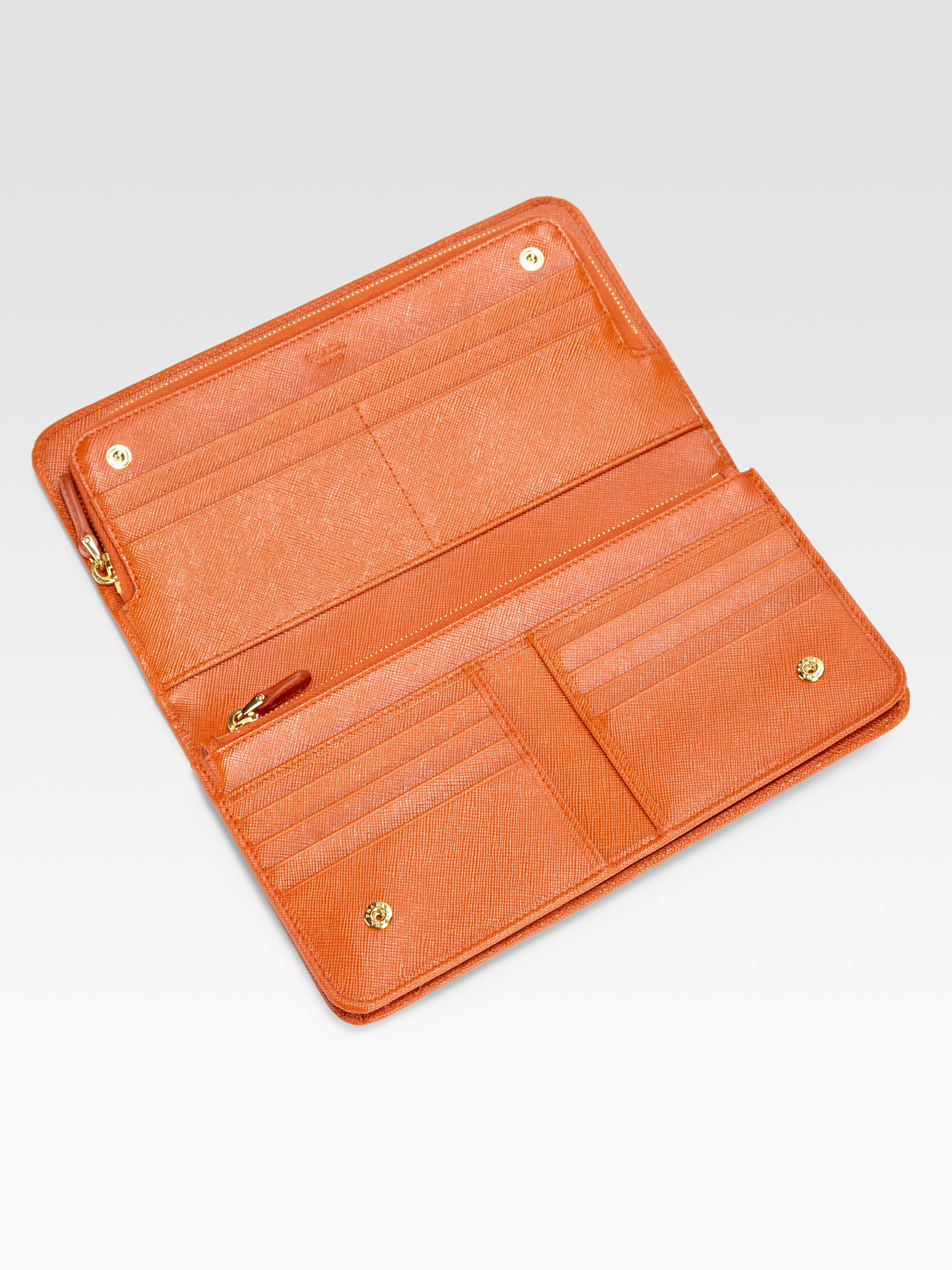 87644acd22a899 ... coupon code for lyst prada saffiano double snap travel wallet in orange  6df84 da517