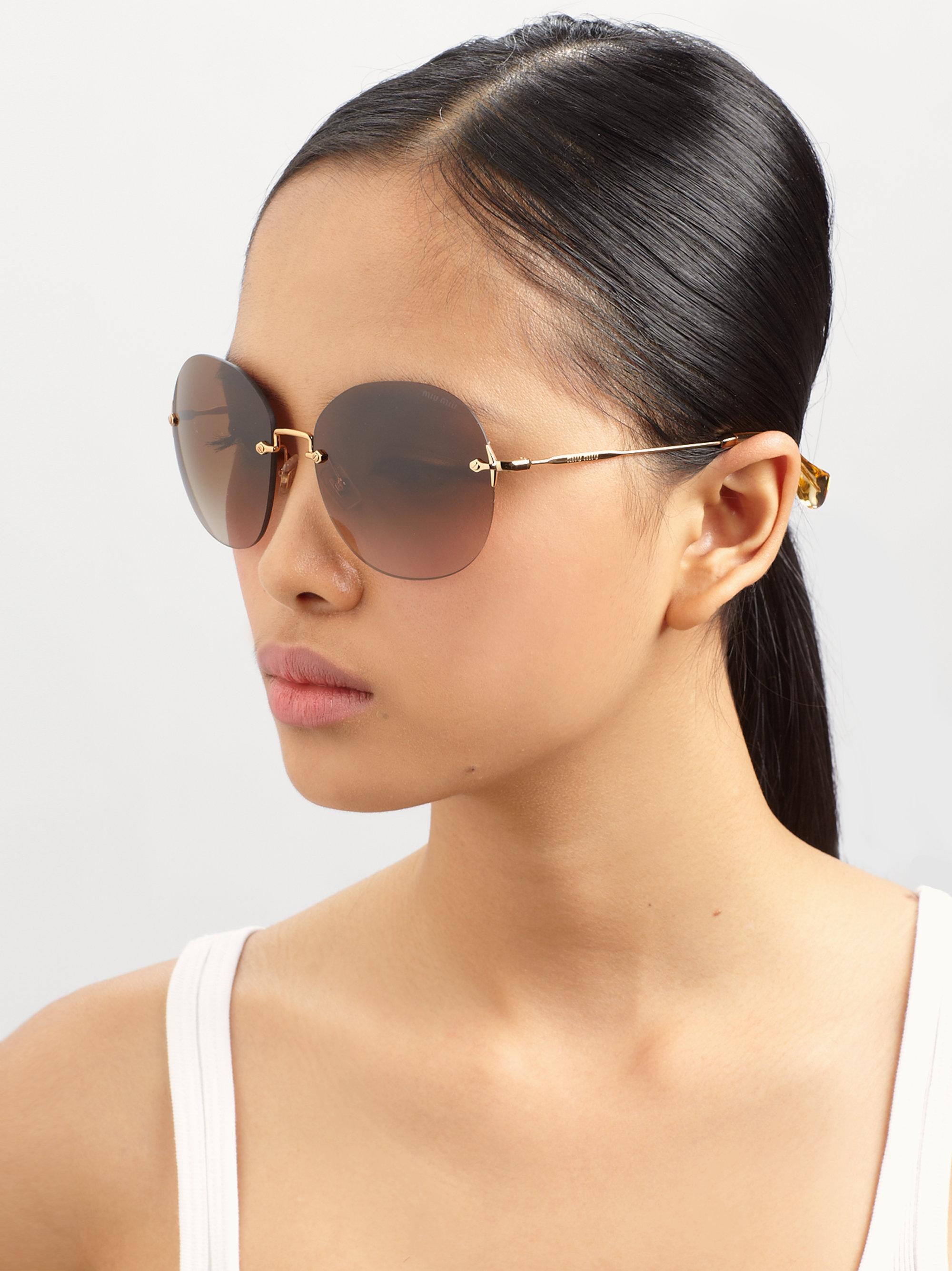 Miu Miu Sunglasses Round  miu miu round metal rimless sunglasses in gray lyst