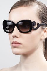 Prada Curved Temple Sunglasses  - Lyst