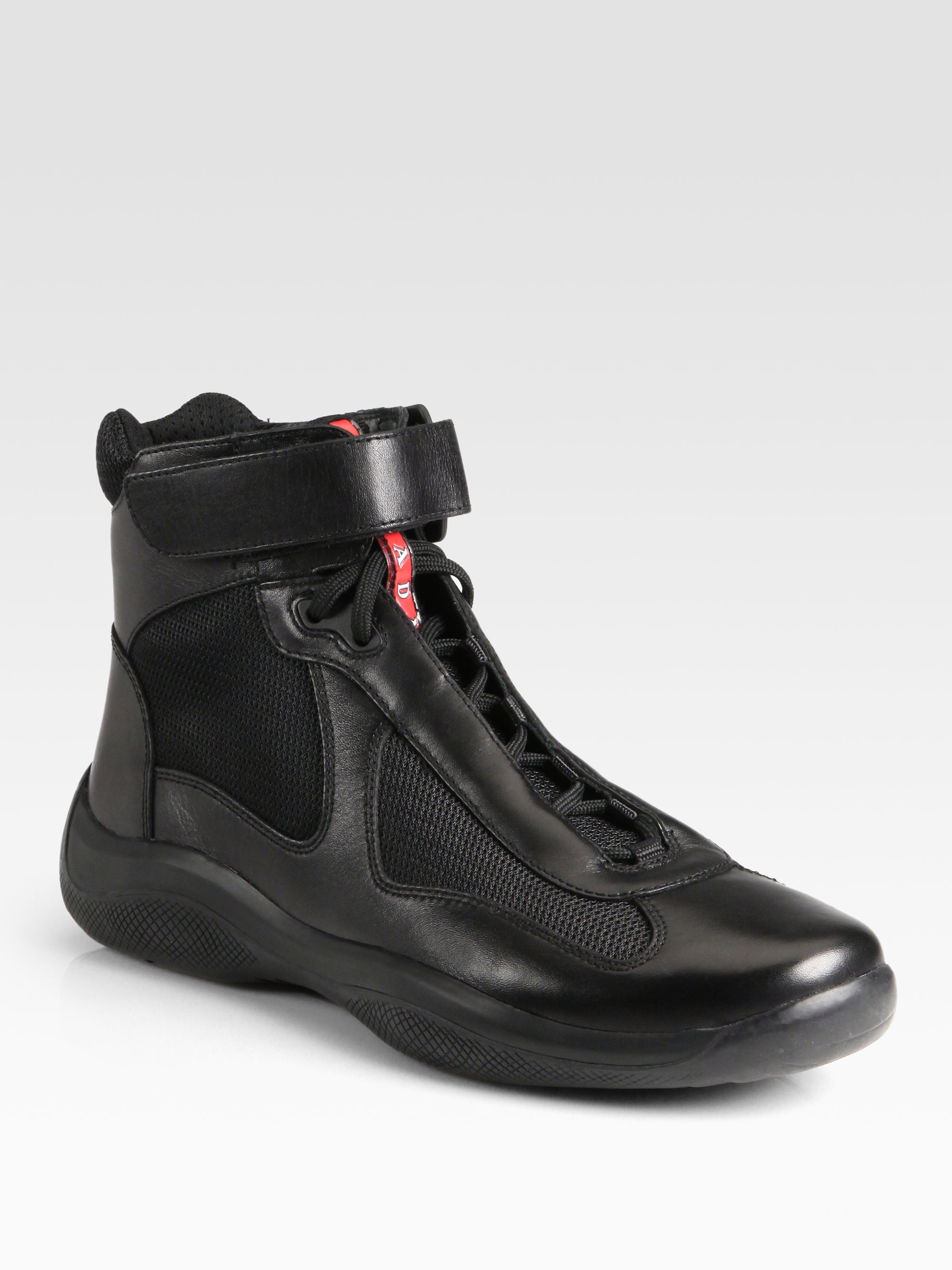 1387c6629cc2 ... order lyst prada sneakers avenue ankle boots silver inserts in black  10c1a 3025c