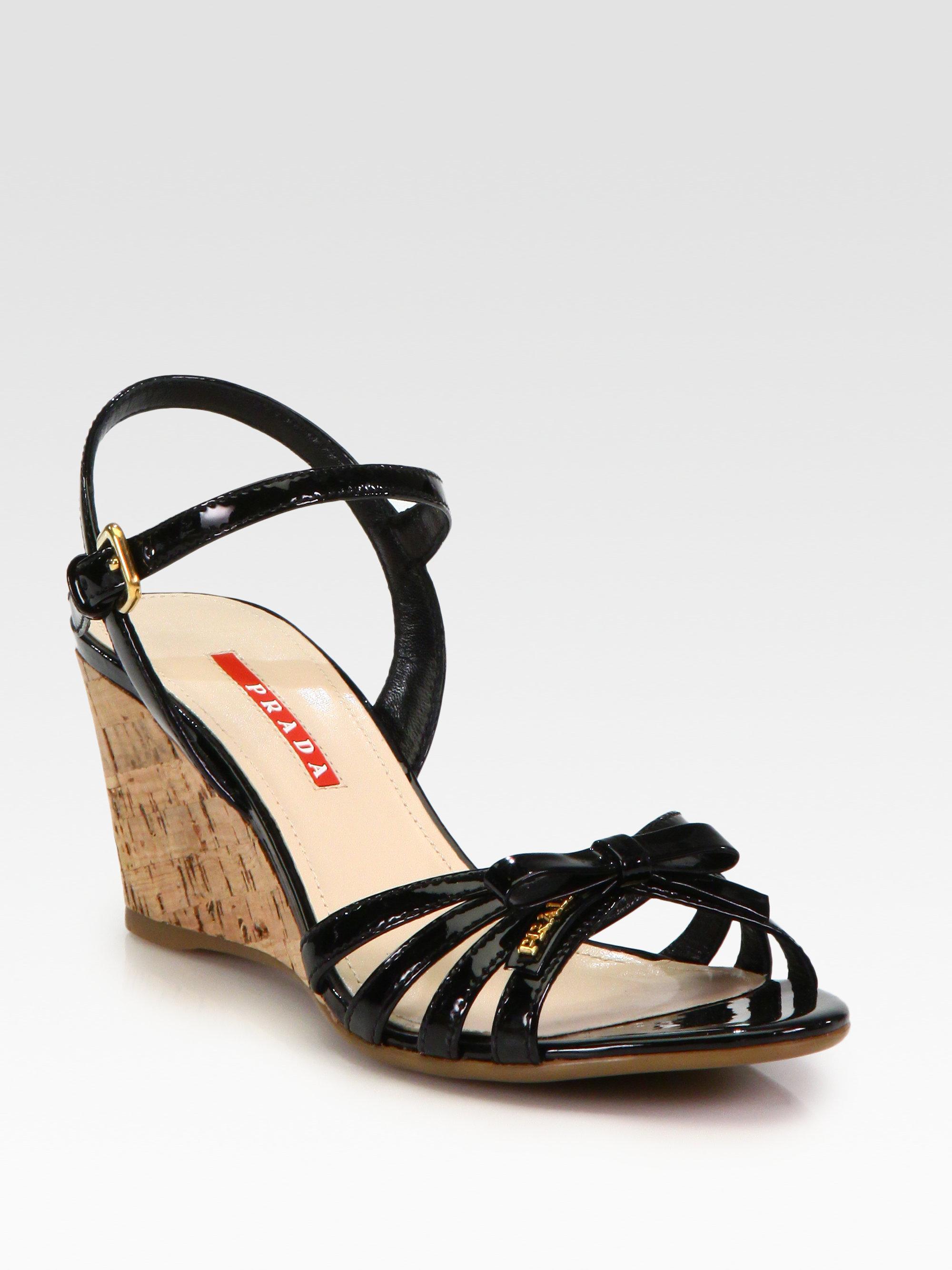 53597b87f1b Prada Leather Bow Cork Wedge Sandals in Black - Lyst