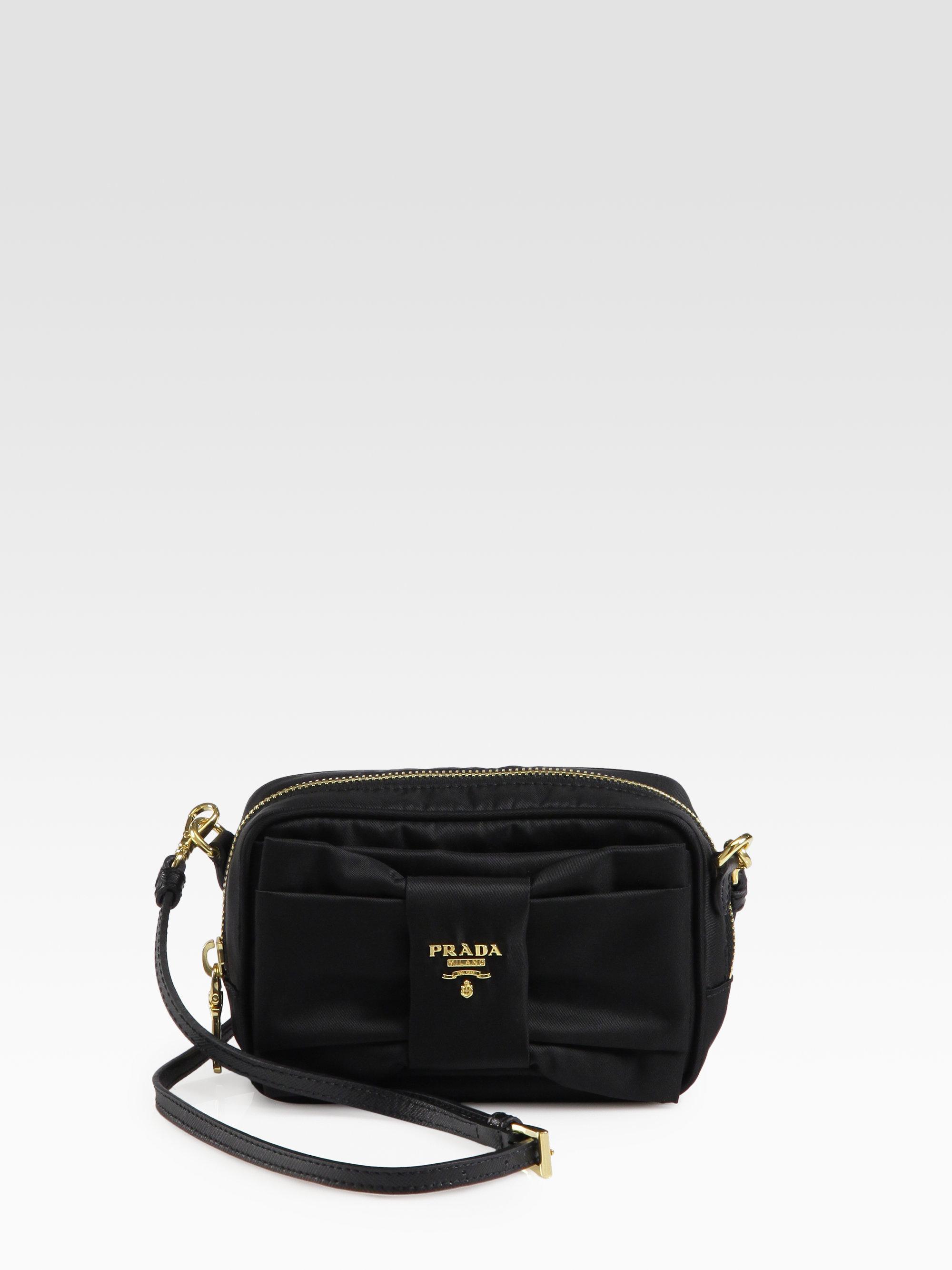 34bd6a5a72 Lyst - Prada Tessuto Bow-Detail Cross-Body Bag in Black