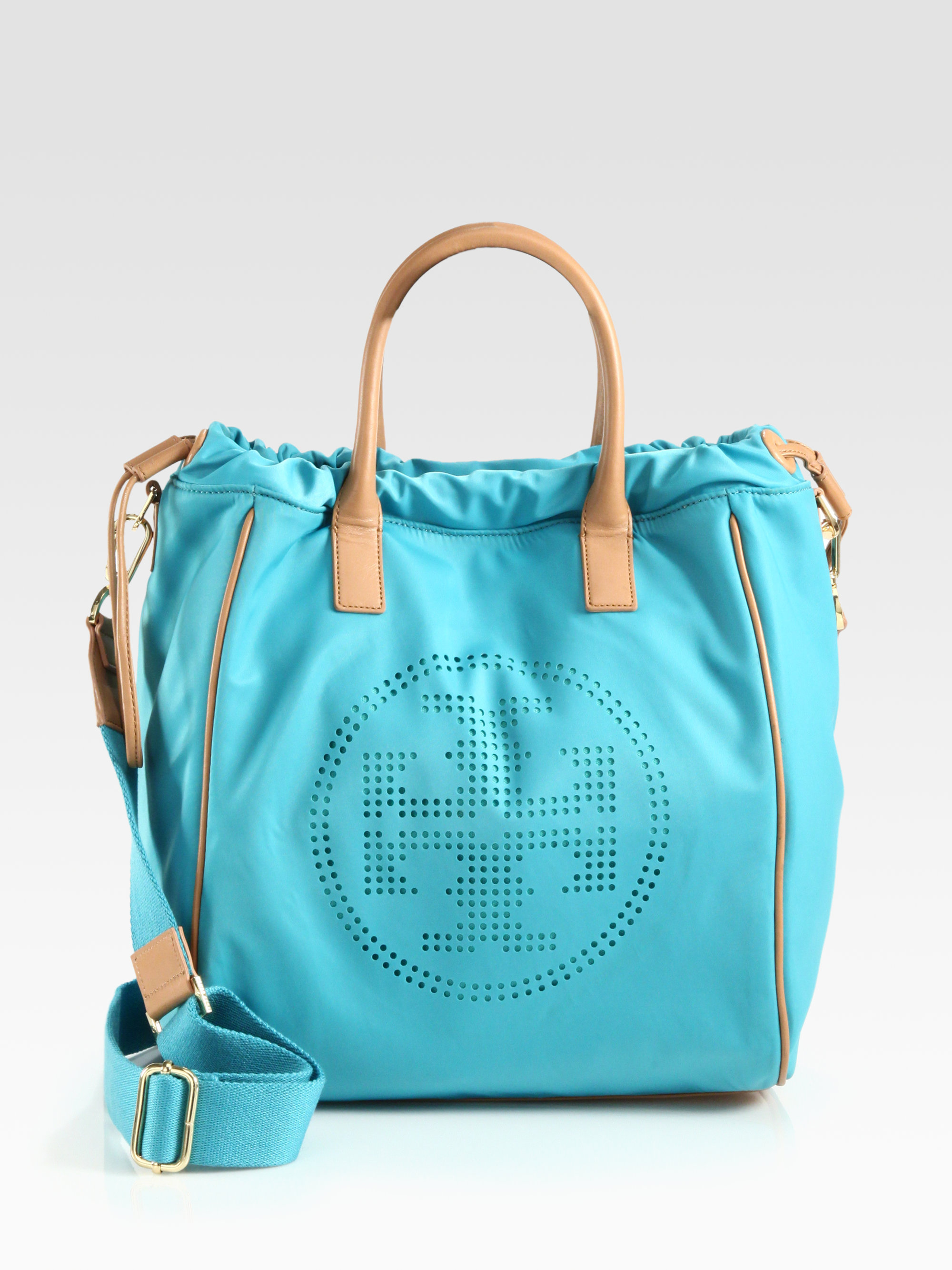 2ffa5f5761cd Lyst - Tory Burch Perforated Nylon Drawstring Tote in Blue