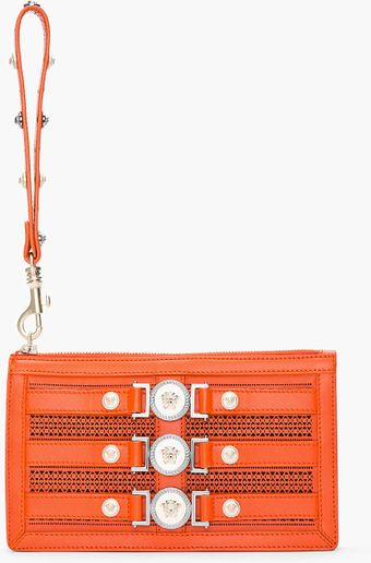 Versace Orange Leather Medallion Cutout Wristlet Clutch - Lyst