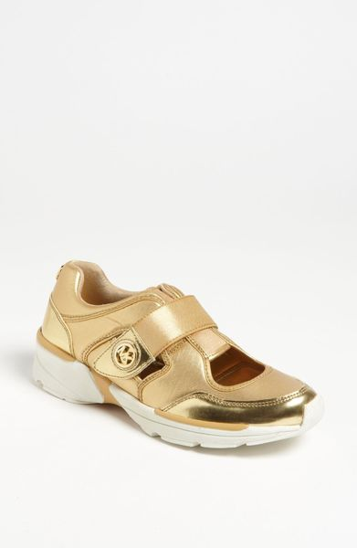 michael by michael kors walker cutout sneaker in gold lyst. Black Bedroom Furniture Sets. Home Design Ideas