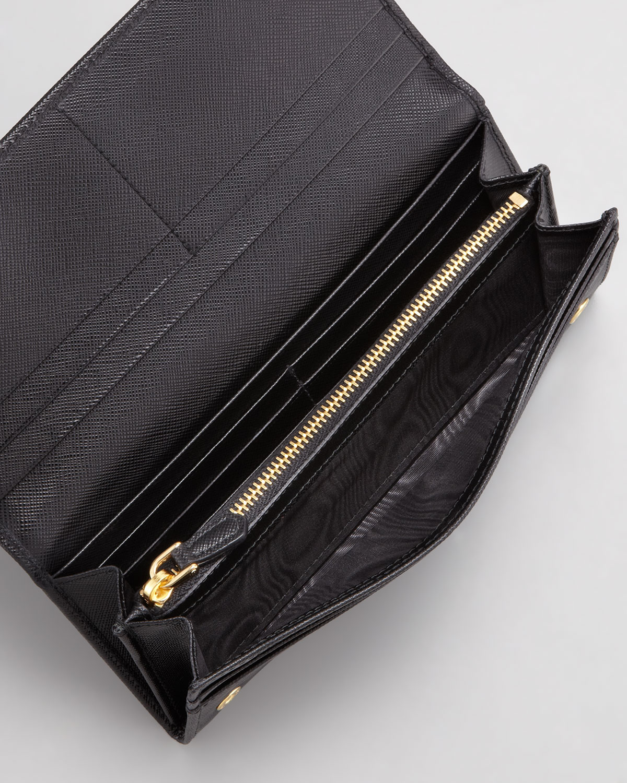 43764fda98dc ... clearance lyst prada saffiano triangle continental flap wallet in black  6ca6b 02490