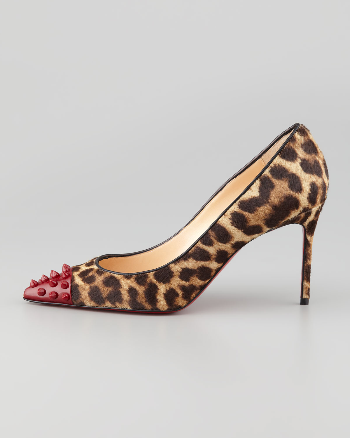 bf78a61ebe59 ... official store lyst christian louboutin geo spike toe leopard calf hair  red sole pump 084a3 d03a4