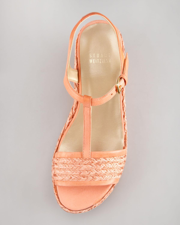 aae1a57d2446 Lyst - Stuart Weitzman Flatty Raffia Braided Wedge Sandal Peach in ...