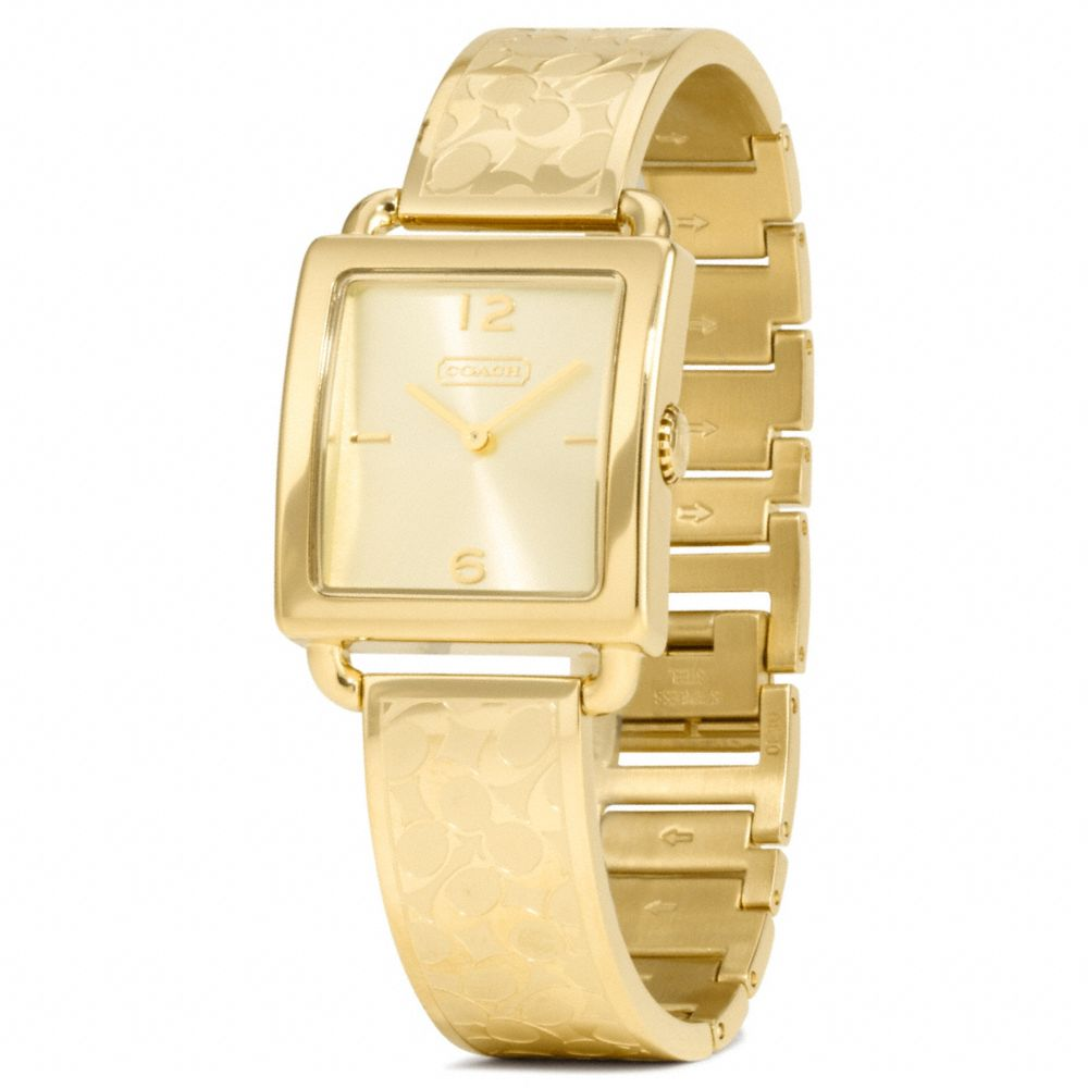 coach legacy gold plated bangle in metallic lyst