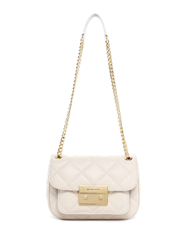how to clean a white mk purse