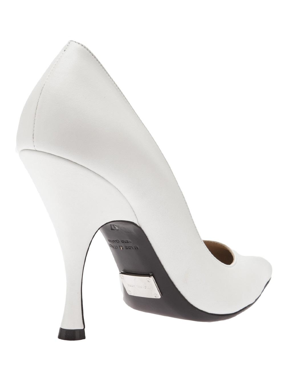 e5b6d2ee3af01 Lyst - Michael Kors Curved Heel Pump in White